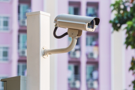 cctv camera: White CCTV camera watching for security 24 hours Stock Photo
