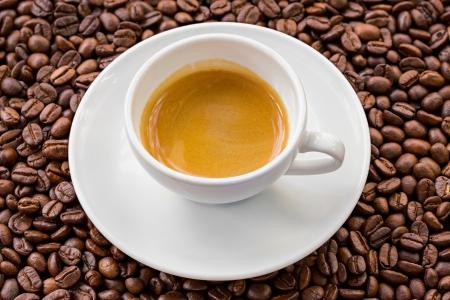 crema: Espresso with golden crema and coffee bean background