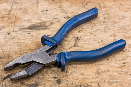 Old and dirty general purpose pliers on grunge wood table Stock Photo - 17921155
