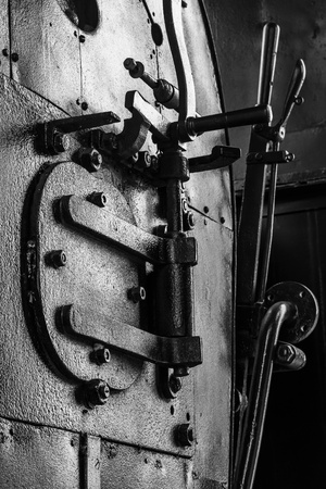 Black and white old train engine photo