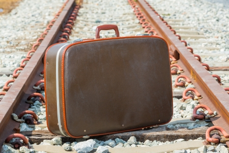 Traveling bag and railway for holiday journey photo