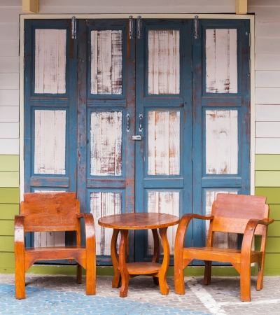 Old and grunge wood chairs and wood wall Stock Photo - 17921058