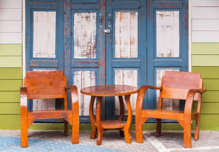 Old and grunge wood chairs and wood wall  photo