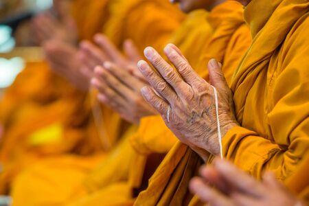 liturgy: Buddhist monks chanting focus on one hand