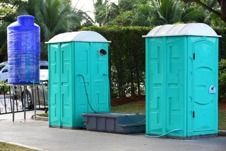 Green color Portable toilet with blue color water tank ready to service people for outdoor event Stock Photo - 17921496