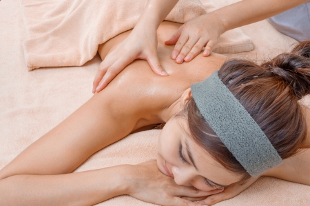 Aromatherapy oil massage in Thai spa photo