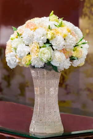Bunch of carnation flower in crystal vase photo