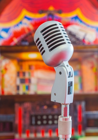 Classic microphone on colorful blur background photo