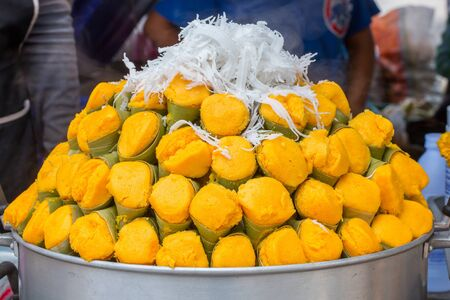 Steamed sugar palm cake with coconut grated coconut photo