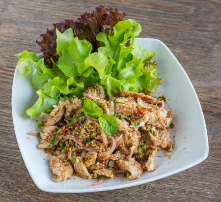 Thai Pork Salad - sliced grilled pork spicy salad served with Lettuce photo