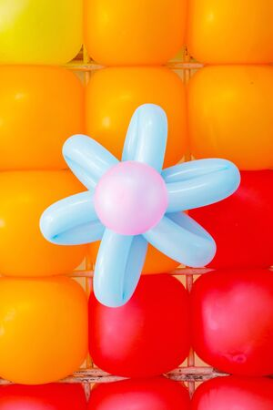 Colorful balloons decoration to flowers and background photo