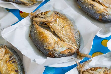 Deep fried Thai mackerel sale in market photo