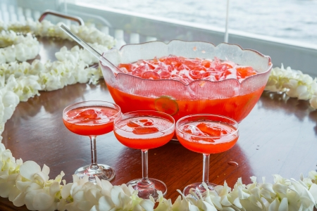 Fruit punch with ice served in beautiful big glass bowl photo
