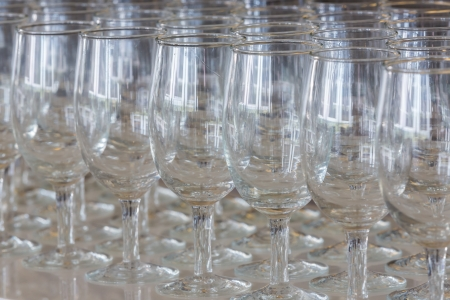 Empty champagne glasses ready to use on bar counter photo