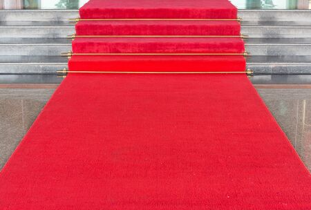 Red carpet on walkway to upstair photo