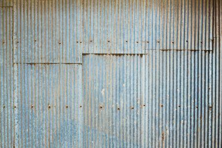 zinc: Grunge Corrugated Zinc Sheet wall Stock Photo