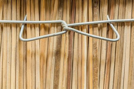 Metal wire for fasten bundle of sticks photo