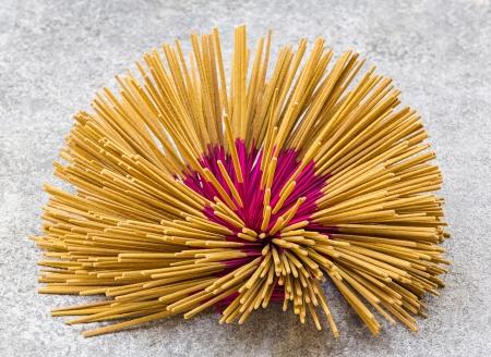 Thai incense sticks preparation in Bangkok photo