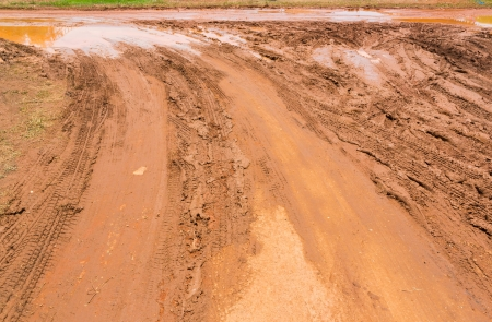Wheel tracks on red color marshy road after raining Stock Photo - 19223459
