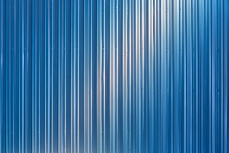 Corrugated metal sheet wall background texture inside of building photo