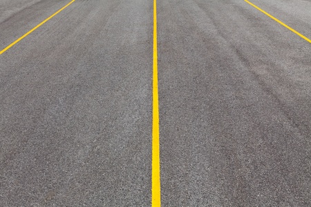 Black color asphalt road with yellow line Stock Photo - 19468825