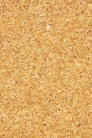 Close up brown color cork board texture background photo