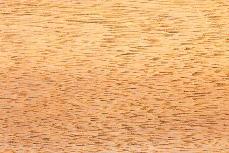 Close up brown color teak wood texture background photo