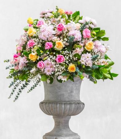 Flower bouquet decoration in grunge concrete vase