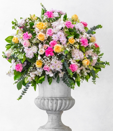 Flower bouquet decoration in grunge concrete vase photo