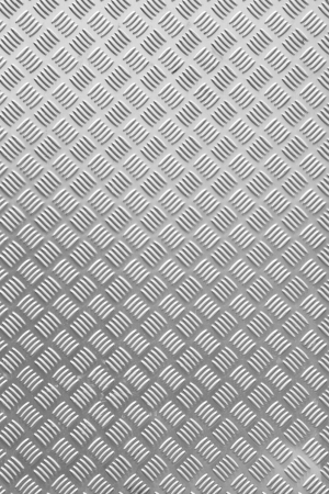 Close up grunge silver color diamond metal plate texture background photo