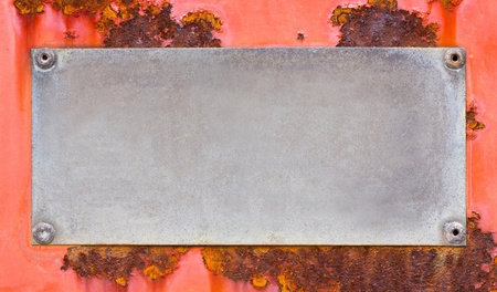 Close up grunge name plate on red color rusty steel sheet Stock Photo - 19929839