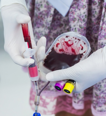 Doctor take Blood sample in tube for examine in laboratory photo