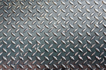 Close up grunge black color diamond metal plate texture background photo