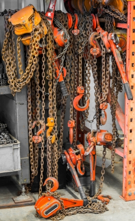 Heavy duty chain hooks and reels in warehouse photo
