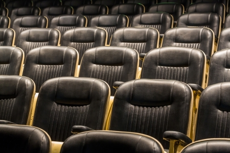 Theater seats in rows from front view photo