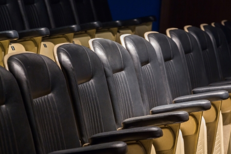 Theater seats in rows from side view photo