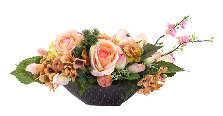 Bouquet of orange color rose and orchid in black ceramic vase isolated on white - artificial flower photo