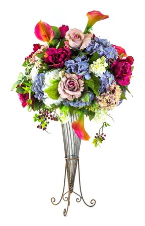 Bouquet of roses hydrangea and calla lily in glass vase isolated on white photo