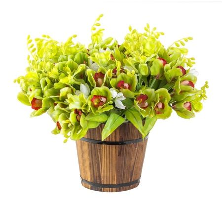 Bouquet of orchid in wood bucket isolated on white photo