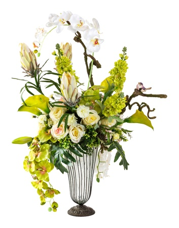 Bouquet of orchid and calla lily in glass vase isolated on white photo