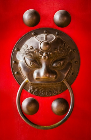Close up grunge and old chinese temple door handle photo