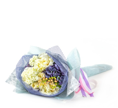 Flower bouquet with bow tie isolated on white photo