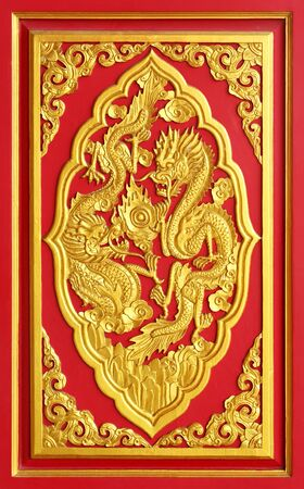 Golden color dragon carved from wood photo