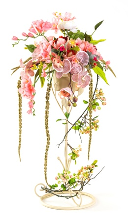 Bouquet of orchid and berry in metal bucket isolated on white photo