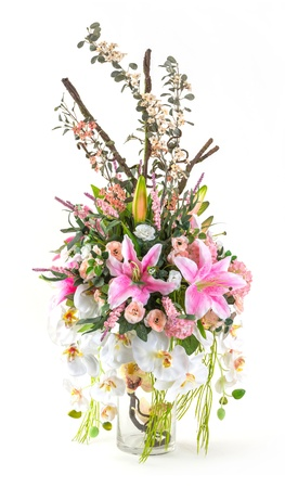 Bouquet of orchid, rose and lily in glass vase isolated on white photo