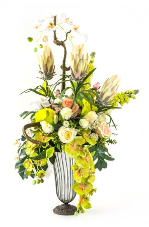 Bouquet of orchid, rose and calla lily flower in glass vase isolated on white photo