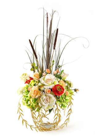 Bouquet of Typha angustifolia Linn, rose and hydrangea flower in glass vase isolated on white photo