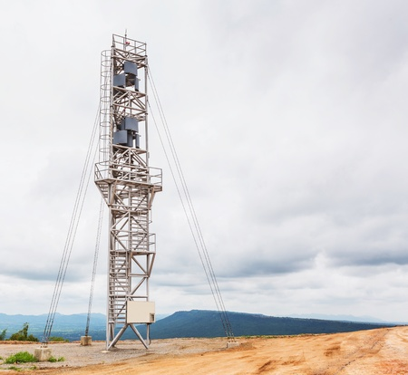 axis: Vertical axis wind turbine tower on top of moutain Stock Photo