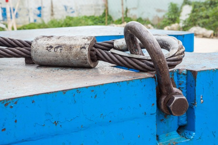 shackle: Close up heavy duty bolt anchor shackle and wire rope sling on crane counter weight
