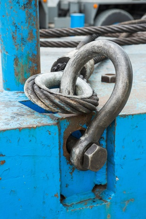 Close up heavy duty bolt anchor shackle and wire rope sling on crane counter weight photo